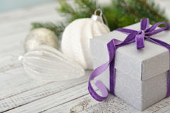 Gift box with violet ribbon Stock Photo
