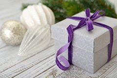 Gift box with violet ribbon Royalty Free Stock Image