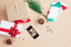 The gift box was placed with decorations items of Christmas day. Concept that was changed by the era. Until the modern era, giving gifts is easy through smart Stock Photo