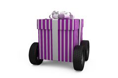 Gift box with wheel Stock Images