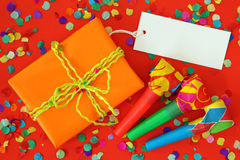 Gift box and whistles Stock Photos
