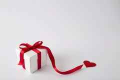 Gift box on the white background. Red ribbon. Valentines Day . Isolated Royalty Free Stock Photos