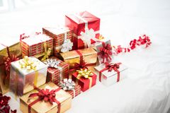 Gift box on white bed sheet background for surprise Children in. New year or Xmas party festival. Relaxing holiday and Object concept. Christmas party event and Royalty Free Stock Photography