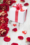 Gift box on a white board with red roses Stock Image