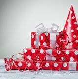 Gift box with white bow ribbon and serpentine. stock photos