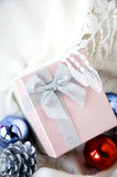 Gift box on white clothing Stock Photo