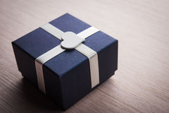 Gift box with white heart shape Stock Images