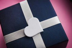 Gift box with white heart shape Royalty Free Stock Photography