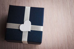Gift box with white heart shape Royalty Free Stock Photos