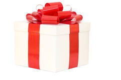 Gift box white with a red ribbon Stock Image