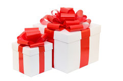 Gift box white with a red ribbon Stock Images