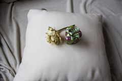 Gift box with white rose on the pillow Stock Photos