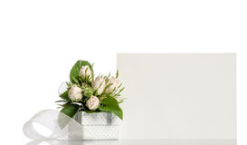 Gift box and white roses with empty card for you text Royalty Free Stock Photography