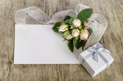 Gift box and white roses with empty card Royalty Free Stock Image