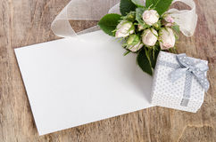 Gift box and white roses with empty card for you text Stock Photo