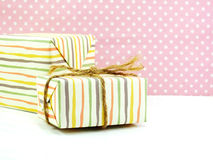 Gift box on white and sweet polka dot Royalty Free Stock Photography