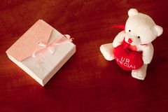 Gift Box And A White Teddy Bear On The Table Royalty Free Stock Image