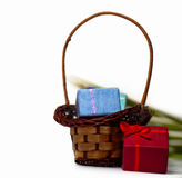 Gift boxes and wicker basket Stock Photos