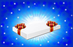 Gift box is on winter background. Gift box with red bows are on winter background Royalty Free Stock Images
