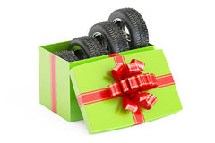 Gift Box with Winter Wheels, 3D rendering. On white background Royalty Free Stock Images