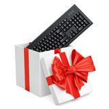 Gift box with wireless computer keyboard, 3D rendering. Isolated on white background Royalty Free Stock Photos