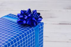 Free Gift Box With Blue Shiny Bow. Stock Photography - 130066782