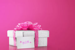 Gift Box With Pink Ribbon For Mom Royalty Free Stock Image
