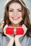 Gift box woman hold against gray background. Close up portrait of young smiling model stock photos