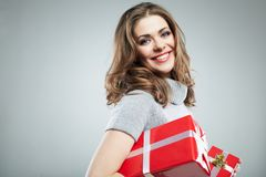 Gift box woman hold against gray background. Stock Image
