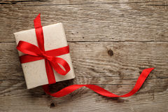 Gift box on wood Stock Images