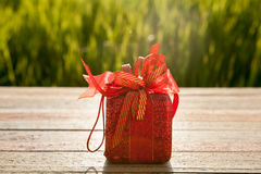 Gift box on wood table in sunset for lover Royalty Free Stock Images