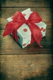 Gift box on wood Royalty Free Stock Photos