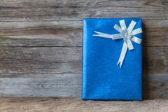 Gift box. With wooden background Royalty Free Stock Photos