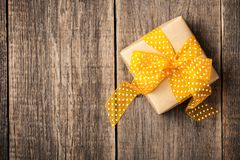 Gift box on wooden background Stock Photos