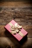 Gift box on wooden background Stock Photography