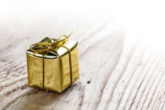 Gift box on wooden background Royalty Free Stock Photography