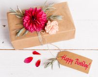 Gift box on the wooden background. Red ribbon. Valentine`s Day gift. Gift box with beautiful flower arrangement and greeting card with the inscription Happy stock photos