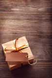 Gift box on a wooden background Royalty Free Stock Image
