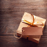 Gift box on a wooden background Royalty Free Stock Images