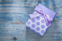 Gift box on wooden board holidays concept Stock Photography