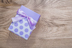 Gift box on wooden board top view celebrations concept Stock Images