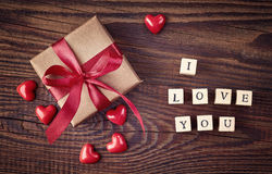 Gift box and wooden cubes with text I love you Stock Image