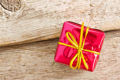 Gift box on the wooden floor Royalty Free Stock Images