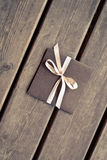 Gift box on a wooden floor Stock Image