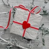 Gift box on a wooden grey shabby chic background Royalty Free Stock Photos