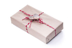 A gift box with wooden hearth isolated on white background Royalty Free Stock Photo