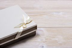 Gift box on wooden light background. Space for text stock photo