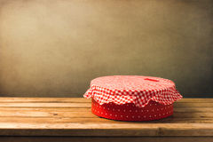 Gift box on wooden table. Against grunge background royalty free stock images