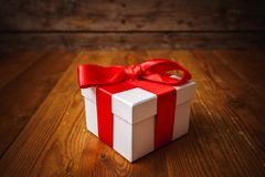 Gift box with wooden. Table Stock Photos