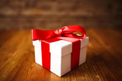 Gift box with wooden. Table Royalty Free Stock Photography
